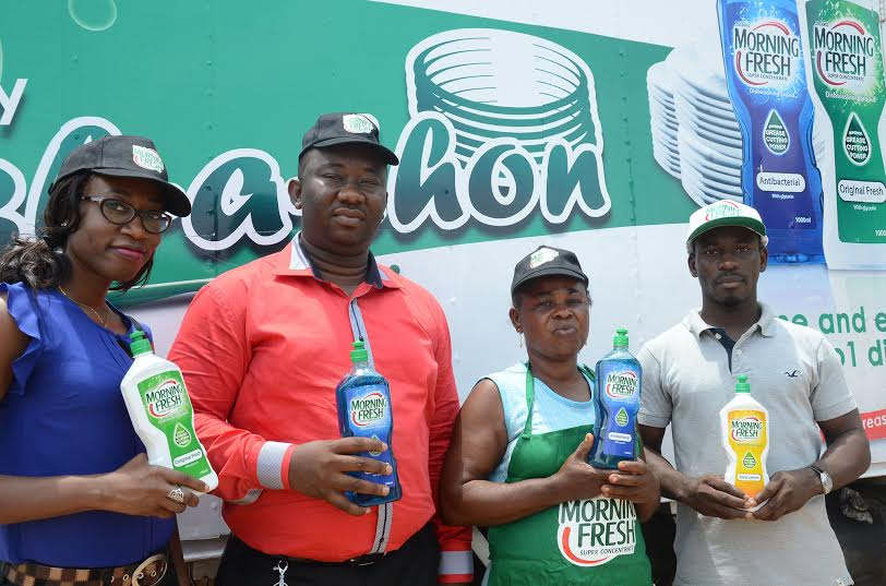 (L-R Brand Manager Morning Fresh, Miss. IminaboGeorgewill; Area Sales Manager Morning Fresh Abuja, Mr. Kevin Emeanuwa; A Customer, Mrs. Emily Uzoka; and Another Customer, Mr. OladapoOlatunji ,during Morning Fresh Community Wash-A- Thon activation in Abuja.)