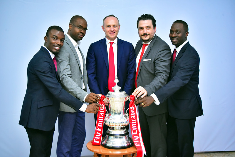 Assistant Brand Manger, Star Lager Beer, Kolawole Akintimehin, Portfolio Manager, National Premium, Nigerian Breweries, Tokunbo Adodo, Partnership Manger, Arsenal Football Club, Gordon Tannock;Marketing Director, Nigerian Breweries; Franco Maria- Maggi; Senior Brand Manager, Star Lager Beer, Abayomi Abidakun are pictured at the Nigerian breweries headquarters alongside the trophy just two weeks after the club won it for a record 13th time.