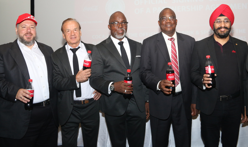 L-R: Georgios Polymenakos ,Managing Director of Nigeria Bottling Company at the Coca-Cola Nigeria Limited,  Gernot Rohr, The Super Eagles Technical Adviser, Mr Amaju Pinnick, The President of the Nigeria Football Federation, Olusade Adesola, Permanent Secretary, Federal Ministry of Youth & Sports Development, representing Solomon Dalung, Honourable Minister of Youth & Sports Development, Bhupendra Suri, Managing Director, Coca-Cola Nigeria Limited, at the Coca-Cola, NFF Partnership Press Conference where Coca-Cola was unveiled as the official soft drink of the Super Eagles and all other Nigeria National Football Teams that held at Eko Hotel.