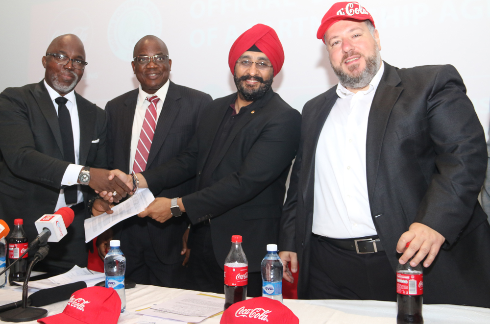 L-R: Amaju Pinnick, President, Nigeria Football Federation (NFF); Olusade Adesola, Permanent Secretary, Federal Ministry of Youth & Sports Development, representing Solomon Dalung, Honourable Minister of Youth & Sports Development; Bhupendra Suri, MD, Coca-Cola Nigeria Limited; and Georgios Polymenakos, MD, Nigeria Bottling Company; at the Coca-Cola Nigeria/NFF Partnership Press Conference where Coca-Cola was unveiled as the Official Soft Drink of the Super Eagles and all other Nigeria National Football Teams, on Wednesday 17 January 2018 at Eko Hotel, Lagos