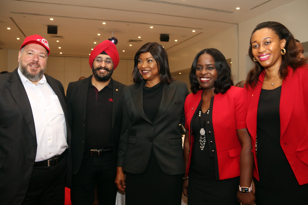 L-R: Georgios Polymenakos, Managing Director of Nigeria Bottling Company; Bhupendra Suri, Managing Director, Coca-Cola Nigeria Limited; Aisha Falode, Chairman of Nigeria Women's Football League (NWFL), Shade Morgan, ‎Legal, Public Affairs and Communications Director, Nigerian Bottling Company; Amaka Onyemelukwe, Manager Public Affairs & Communications, Coca-Cola Nigeria Limited at the Coca-Cola NFF Partnership Press Conference where Coca-Cola was unveiled as the official soft drink of the Super Eagles and all other Nigeria National Football Teams that held at Eko Hotel.