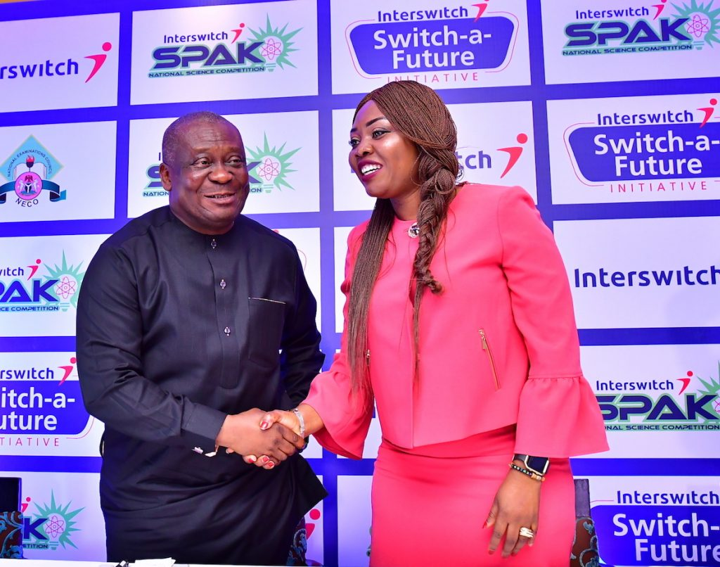 Registrar, NECO. Prof Charles Uwakwe with Chief Marketing Officer, Interswitch, Cherry Eromosele and the media unveil of Interswitch SPAK Initiative