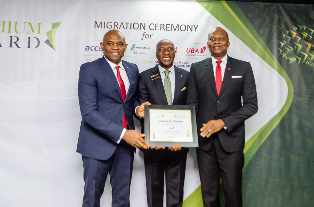 L-R: Chairman, United Bank for Africa, Mr. Tony Elumelu; CEO, Nigerian Stock Exchange, Mr. Oscar Onyeama and Group Managing Director/CEO, United Bank for Africa,  Mr. Kennedy Uzoka, during the official ceremony to announce the migration of United Bank for Africa Plc and three other companies to the Premium Board of the Nigerian Stock Exchange on Monday
