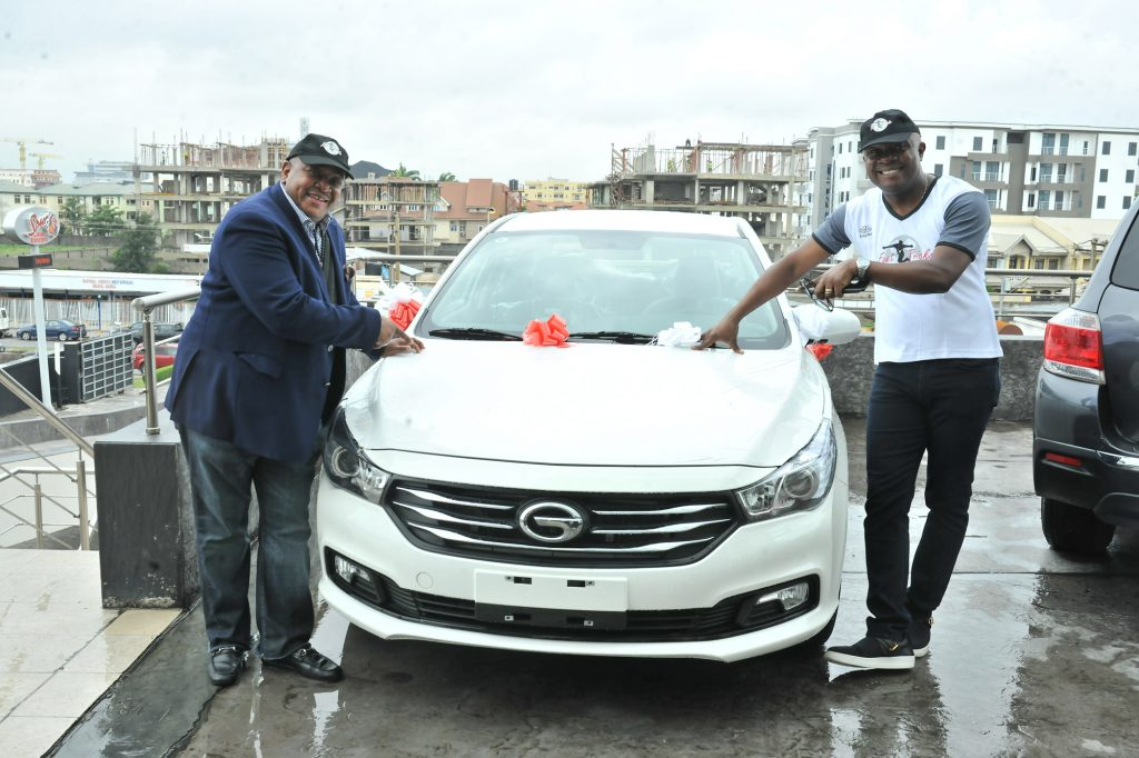 Valentine Ozigbo; Chairman, Feet 'n' Tricks International and Olisa Adibua, Director, Feet 'n' Tricks International, with the Grand Prize of Saloon Car donated by one of the Sponsors GAC Motors Africa during the Press Conference to announce the commencement the call for entries for Freestyle Football 2018 African Championship to be organised by Feet 'n' Tricks International in partnership with the World Freestyle Football Association (WFFA), in Lagos Recently