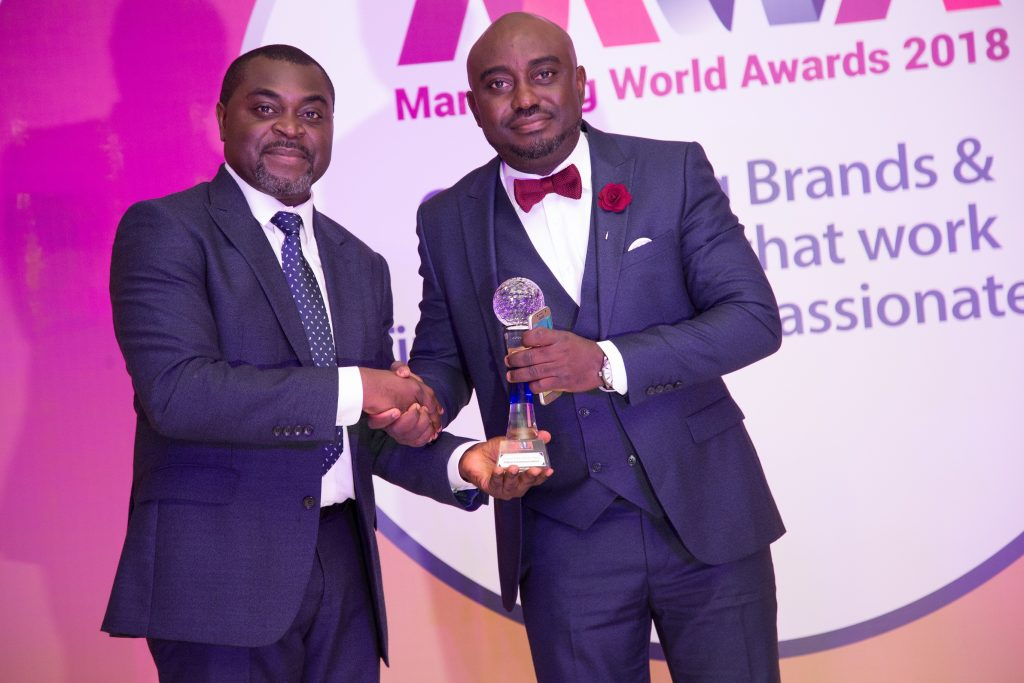 The Chief Executive Officer, Modion Communications, Mr. Odion Aleobua (right), receiving the award for Innovative PR Agency of the Year, from Mr. Akin Naphtal, the CEO, Instinct Waves and organiser of the 2018 8th Marketing World Awards held at Mövenpick Ambassador Hotel, in Accra, Ghana, on Friday, November 16, 2018.